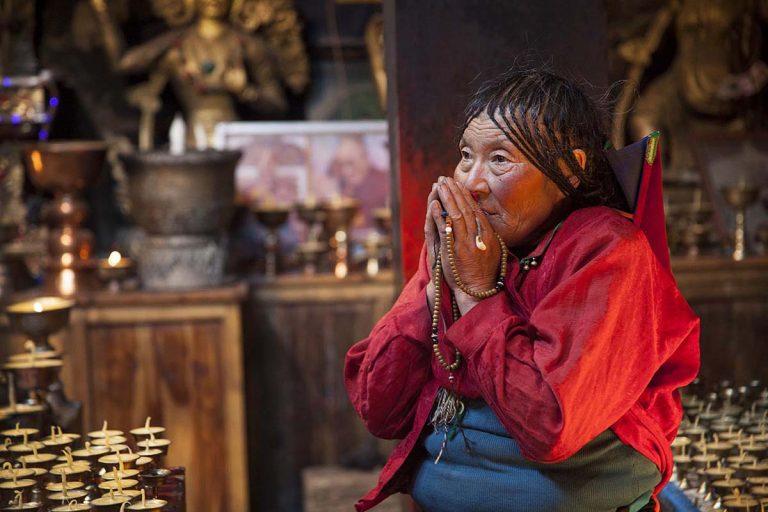 Tibetan woman praying